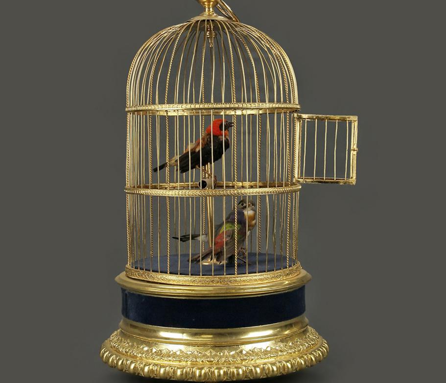 Три механические поющие птички в клетке